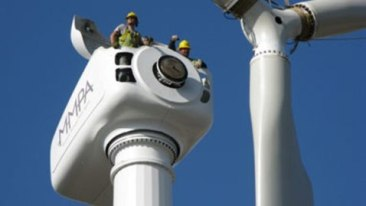 Construction workers building wind turbine